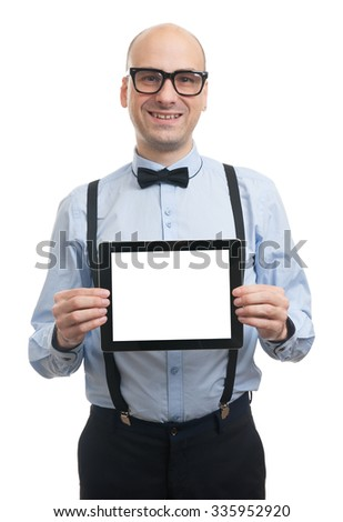 handsome bald man wearing bow tie and suspenders showing digital tablet screen - stock photo
