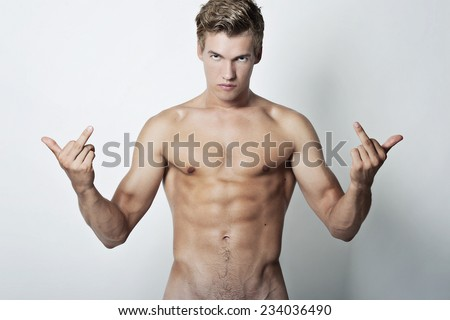 Handsome bare chested young man - stock photo