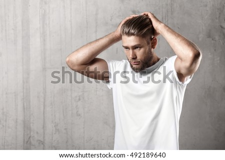 Handsome bearded guy in a blank white t-shirt with stylish hair