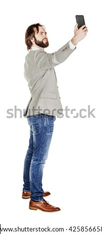 Handsome bearded young business man taking selfie smiling. portrait isolated over white studio background. - stock photo