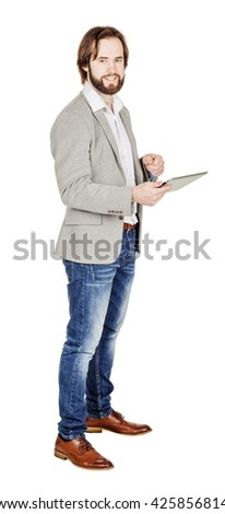 Handsome bearded young business man using digital tablet. portrait isolated over white studio background. - stock photo