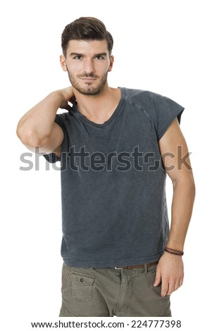 Handsome bearded young man with a lovely charismatic smile wearing a cotton t-shirt, isolated on white