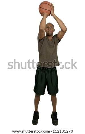 Handsome black African American man playing basketball - stock photo