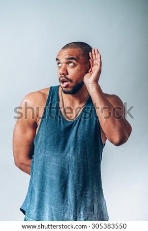 Handsome black african man overhears - stock photo
