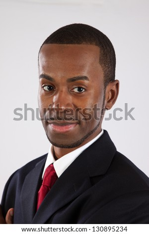 Handsome black businessman looking at the camera with an assured smile