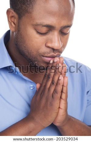 handsome black man closed eyes. Man praying in solitude and patience - stock photo