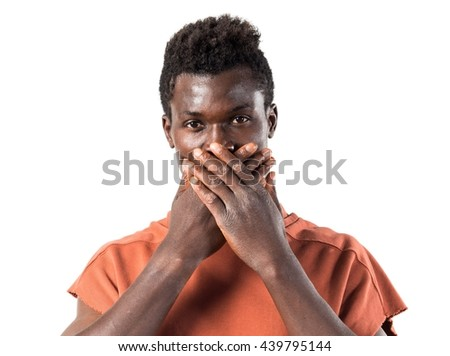 Handsome black man covering his mouth - stock photo