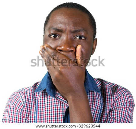 Handsome black man covering mouth with hand - stock photo