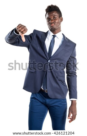 Handsome black man doing bad signal - stock photo