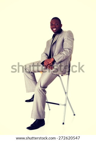 Handsome black man sitting on a chair