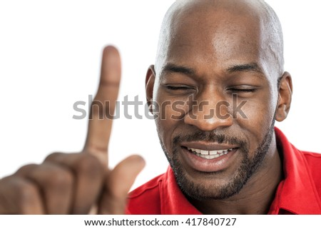 Handsome black man with eyes closed showing number one isolated on white