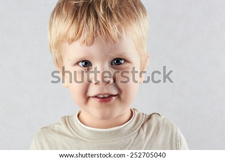 handsome  blond boy  Looking At Camera. Positive human emotion facial expression feelings - stock photo