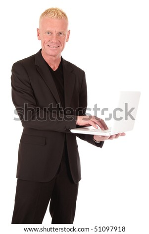 Handsome blond smiling mid forties businessman with laptop.  Studio white background