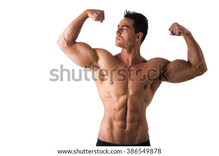 Handsome bodybuilder doing classic double biceps pose - stock photo