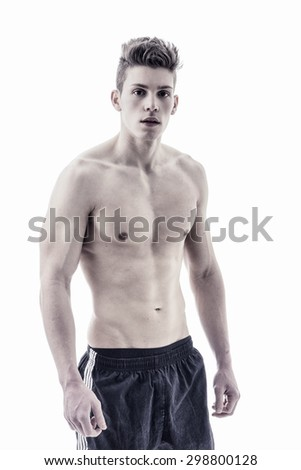 Handsome bodybuilder in relaxed pose, looking at camera isolated on white background - stock photo