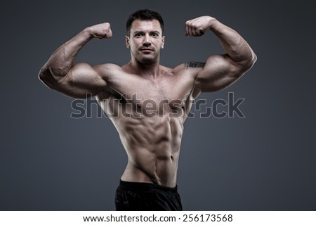 Handsome bodybuilder posing in the studio