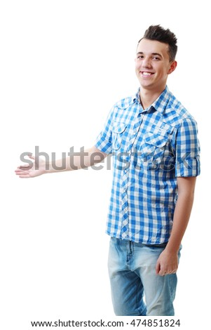 Handsome bold young man in a checked blue shirt presenting something showing empty palm
