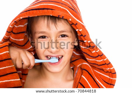 handsome boy brushing his teeth on a white background - stock photo