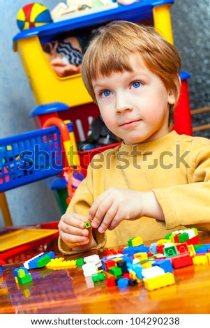 handsome boy designs with blocks - stock photo