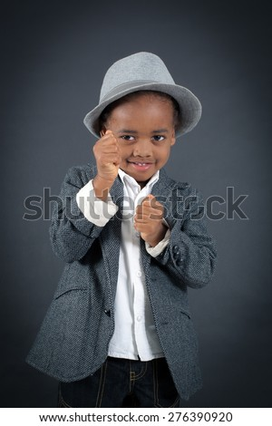 Handsome boy doing different expressions in different sets of clothes: boxe - stock photo