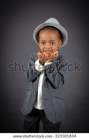 Handsome boy doing different expressions in different sets of clothes: kiss - stock photo