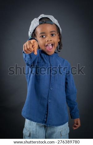 Handsome boy doing different expressions in different sets of clothes: pointing - stock photo