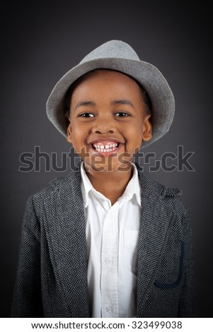 Handsome boy doing different expressions in different sets of clothes: smile - stock photo