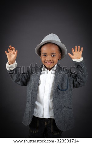Handsome boy doing different expressions in different sets of clothes: waving - stock photo