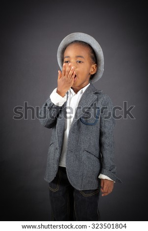 Handsome boy doing different expressions in different sets of clothes: yawn - stock photo