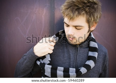 handsome boy dressed in warm clothes - stock photo