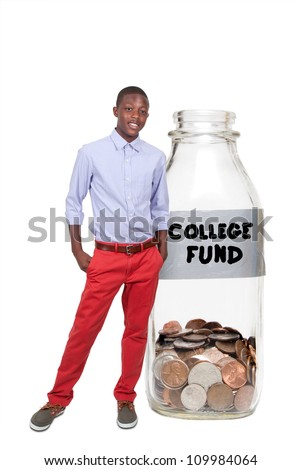 Handsome boy holding her college fund of coins in a milk bottle - stock photo
