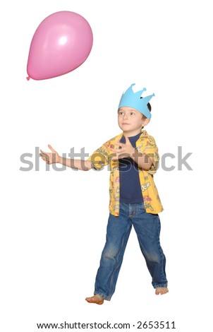 handsome boy in blue birthday crown playing with a pink balloon on white background with a clipping path - stock photo