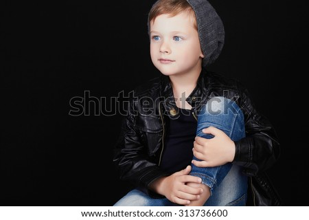handsome boy in jeans.Funny child in hat.fashionable little boy.stylish kid in leather coat - stock photo
