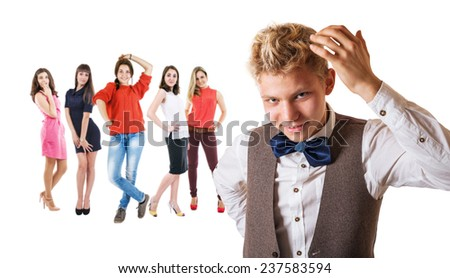 Handsome boy portrait with group of pretty girls - stock photo