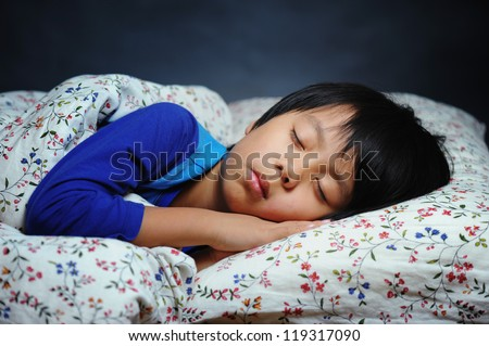 Handsome boy sleeping peacefully - stock photo