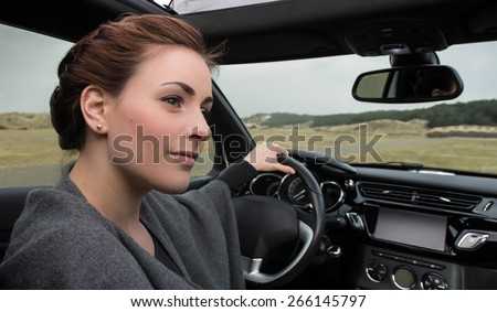 Handsome brunette woman parked car
