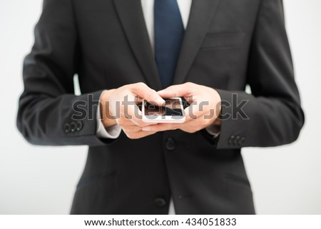 Handsome business asian man using smart phone on white background