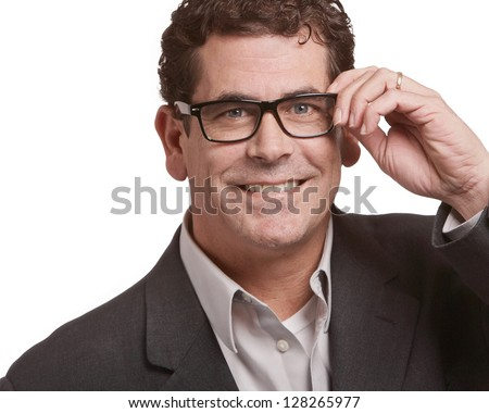 Handsome business man holding glasses isolated on white