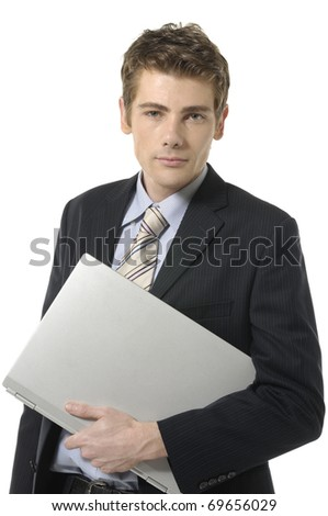 handsome business man holding laptop in his hand. Isolated on white background - stock photo