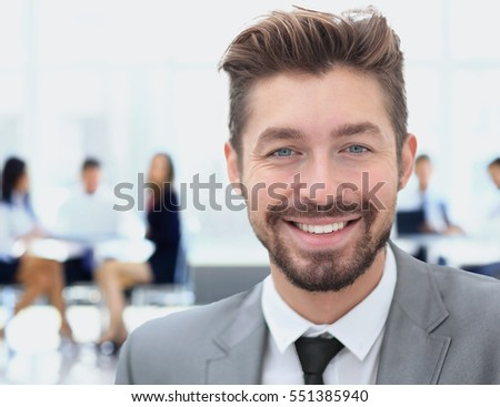 Handsome Business man in an office with blurred  background