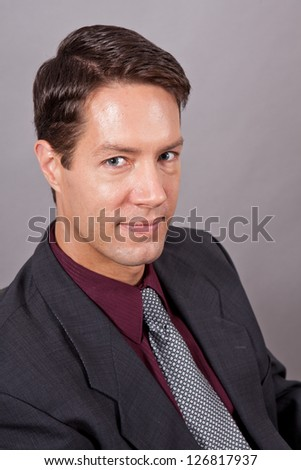 Handsome business man isolated on gray head shot