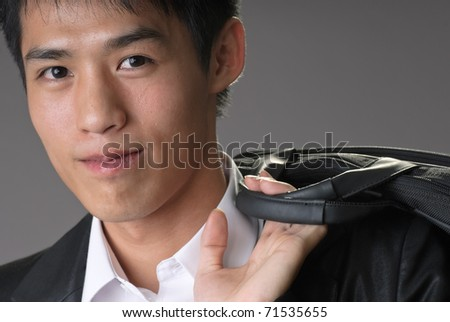Handsome business man of Asian with happy smiling expression. - stock photo