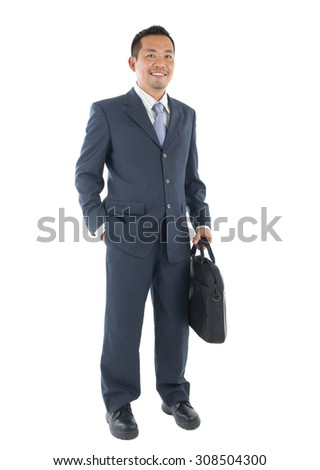 Handsome business man of Southeast Asian, full length portrait. - stock photo