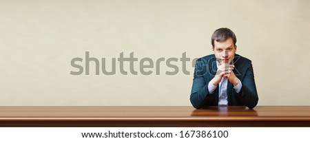 handsome business man on a desk - stock photo