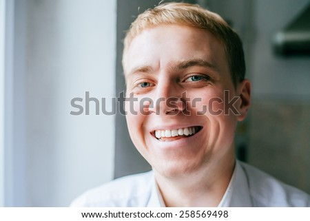Handsome business man portrait smiling at the office - stock photo