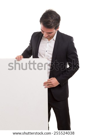 Handsome business man presenting your product on a white board