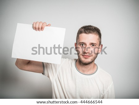 Handsome business man presenting your product or text - stock photo