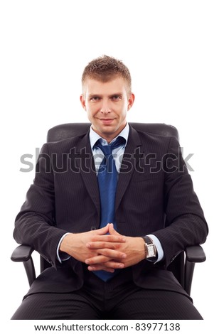 handsome business man sitting in office chair over white