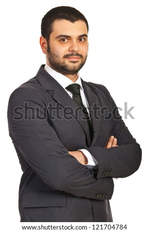 Handsome business man standing with arms folded isolated on white background