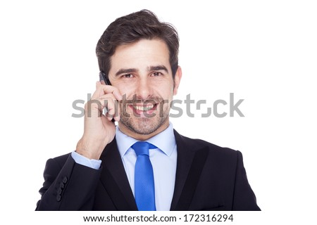 Handsome business man talking on the phone, isolated on a white background - stock photo
